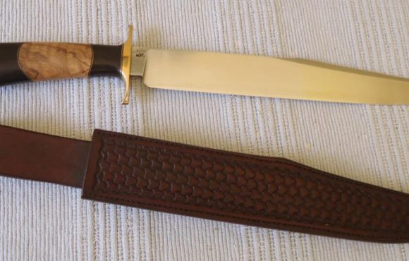 Bowie knife handle of African Blackwood and wild olive and leather sleeve